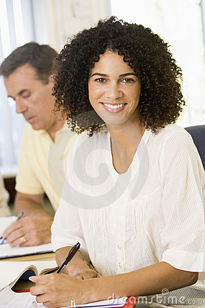 Free Mid Adult Woman Studying With Other Adult Students Stock Image - 7035081