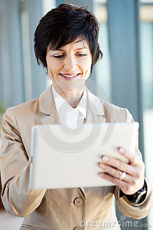Mid age businesswoman tablet computer