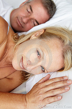 Mid age couple in bed