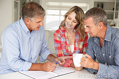 Mid age couple with financial advisor