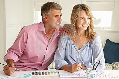 Mid age couple painting at home