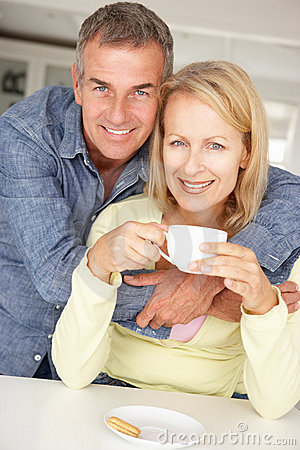 Free Mid Age Couple With Coffee At Home Stock Images - 21044654