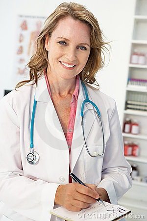 Mid age female doctor writing prescription