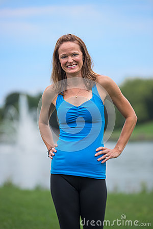 Mid Age Fitness Trainer Woman Outddoor