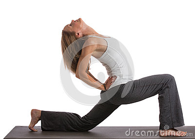 Mid-Age Healthy Looking Female Practicing Yoga