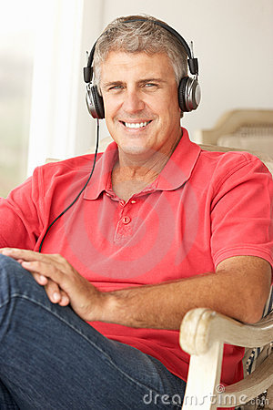 Mid age man wearing headphones