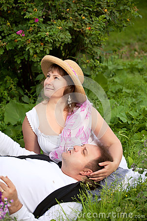 Mid age plus size couple having date in the park. Sunny day