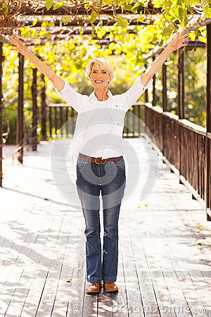Mid age woman arms outstretched