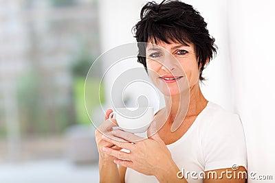 Mid age woman coffee