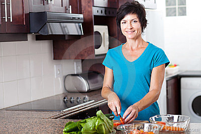 Mid age woman cooking