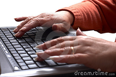 Mid age woman s hands on the laptop