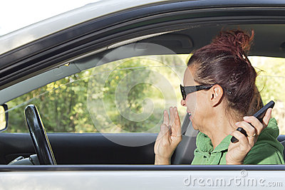 Mid aged woman sneeze in the car