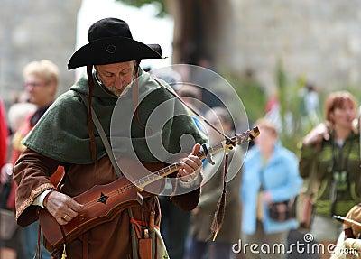 Middeleeuwse troubadour Redactionele Stock Afbeelding