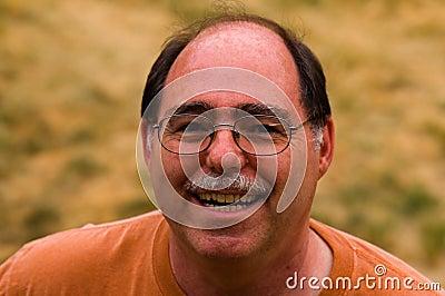 Midden leeftijds balding mens