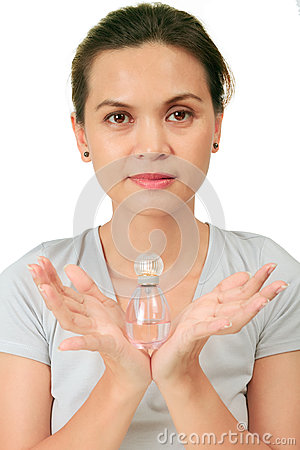 Middle age asian woman with a fragrance bottle