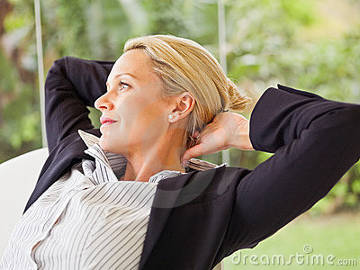 Middle age business woman relaxing, isolated