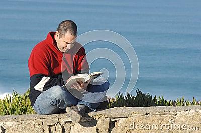Middle age caucasion men reading a book