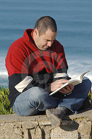 Middle age caucasion men reading a book