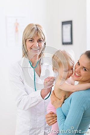 Middle age doctor examine baby using stethoscope