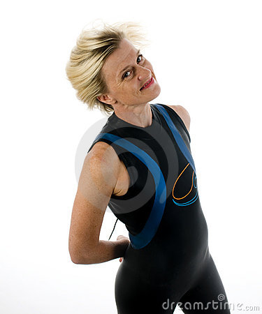 Middle age female triathlete in swimming wet suit