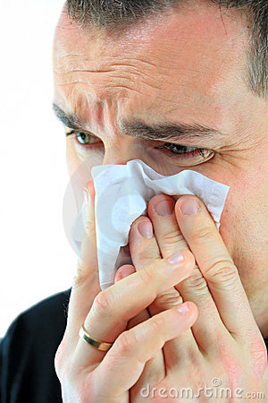 Middle age man with cold holding tissue