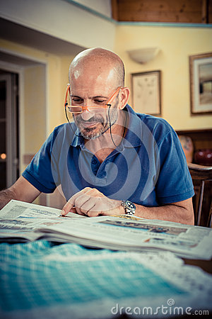Middle age man reading newspaper