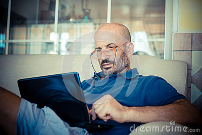 Middle age man using notebook