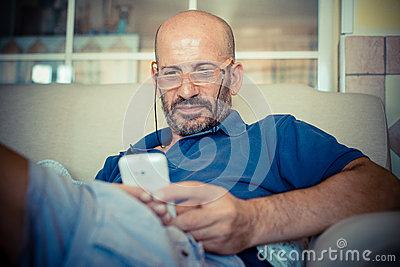 Middle age man using phone