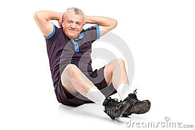 A middle age senior man exercising