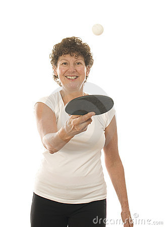 Middle age senior woman playing ping pong