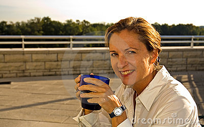 Middle Age Woman Drinking Coffee