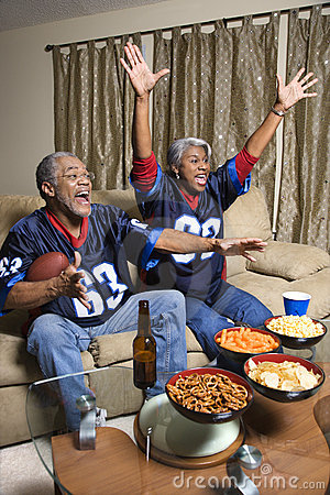 Free Middle-aged African-American Couple Watching Sports On Tv. Stock Photo - 2043820