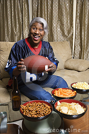 Middle-aged African-American woman holding a football.