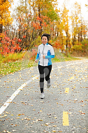Middle aged Asian woman running active in her 50s