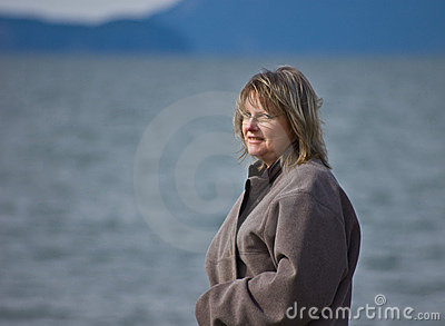 Middle Aged Blond Woman At Ocean