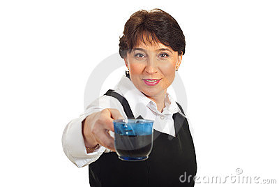 Middle aged business woman giving coffee