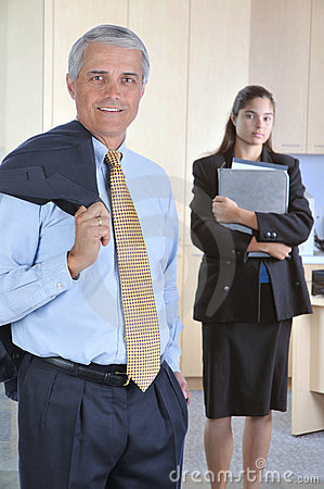 Middle aged Businessman with Assistant