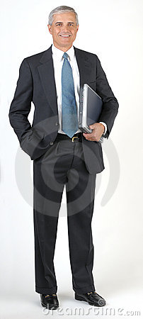 Middle aged Businessman full length hand in pocket