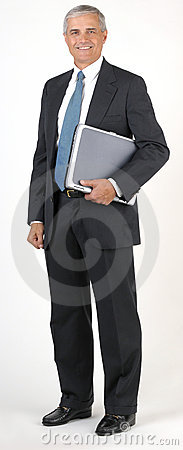 Middle Aged Businessman full length hodling Laptop