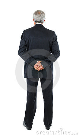 Middle aged Businessman hands behind back