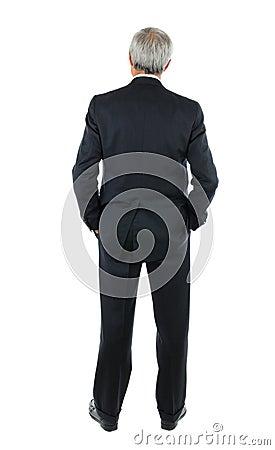 Middle aged Businessman hands in pocket behind