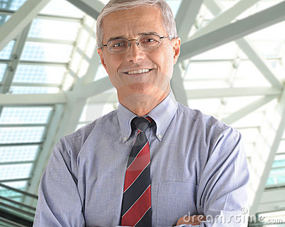 Middle Aged Businessman in office lobby