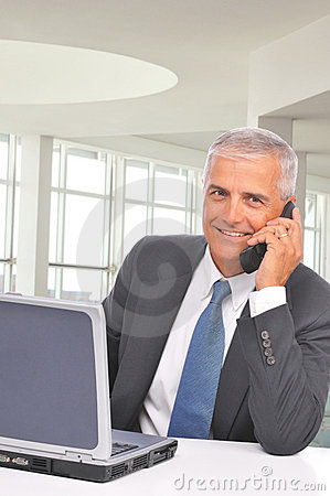 Middle aged Businessman Talking on Cell Phone
