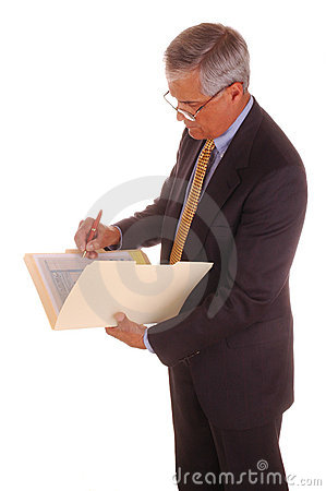 Middle aged Businessman Writing in Folder
