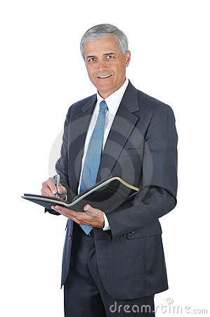 Middle aged Businessman Writing in Notebook