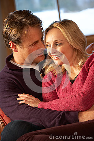 Free Middle Aged Couple Chatting On Sofa In Chalet Royalty Free Stock Photo - 25640235