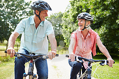 Middle Aged Couple Enjoying Country Cycle Ride Together