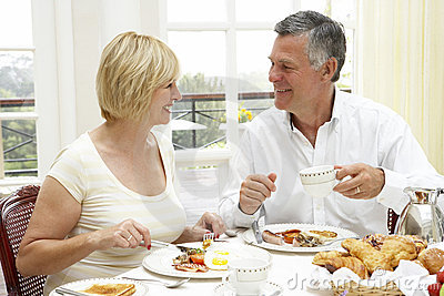 Middle Aged Couple Enjoying Hotel Breakfast