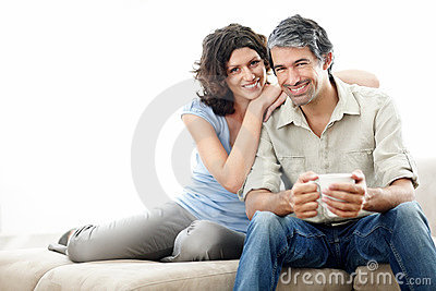 Middle aged couple on sofa with lots of copyspace