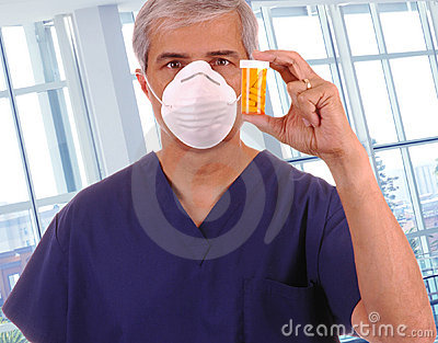 Middle aged Doctor Holding Up Prescription